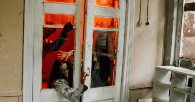 Zombie characters attempting to break through a glass door